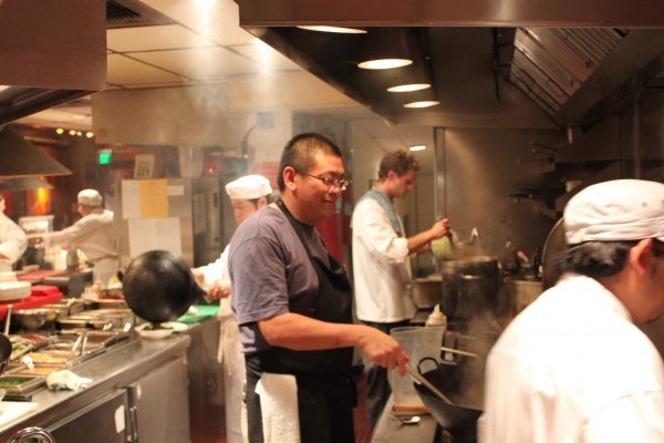 Alex Ong and his team at Betelnut prepare dishes from Naomi's cookbook. (Asia Society)