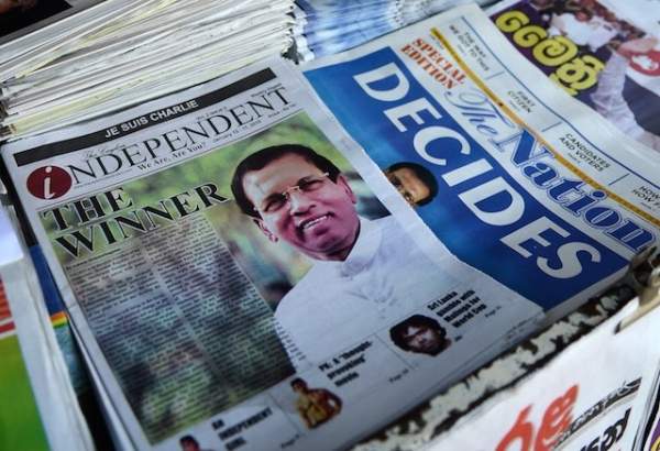 Newspapers for sale at a stall in Colombo on January 10, 2015, leading with headlines about Sri Lanka's new president Maithripala Sirisena. (Akruwan Wanniarachchi/AFP/Getty Images)