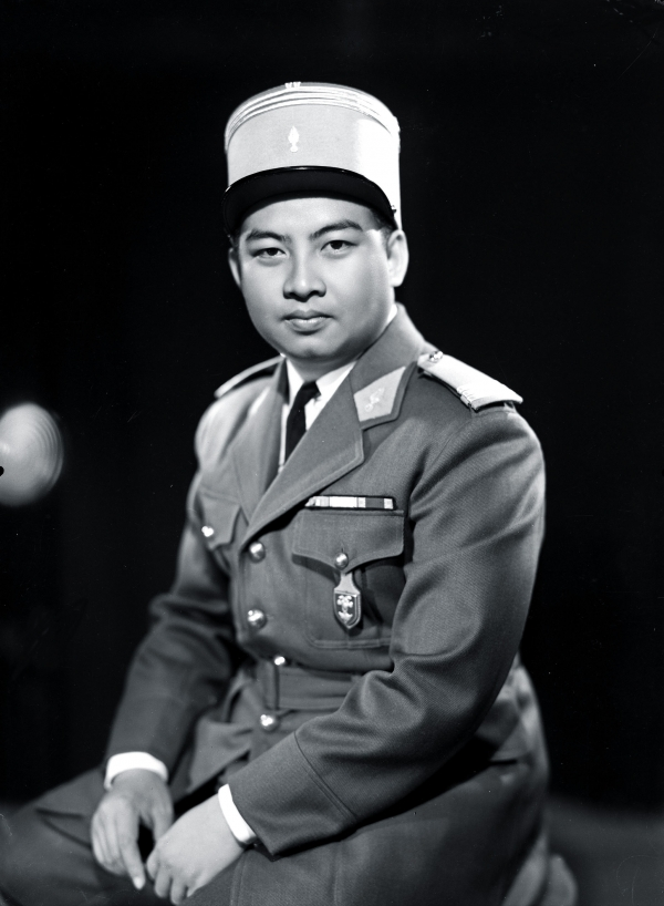 Born on Oct 31, 1922, Sihanouk was selected by the Crown Council to be King in 1941 when his grandfather died. At the time Cambodia was a colony in French Indochina, which included modern-day Vietnam and Laos. Here Sihanouk dons a French-style military uniform for a photographer in 1953. (AFP/GettyImages)