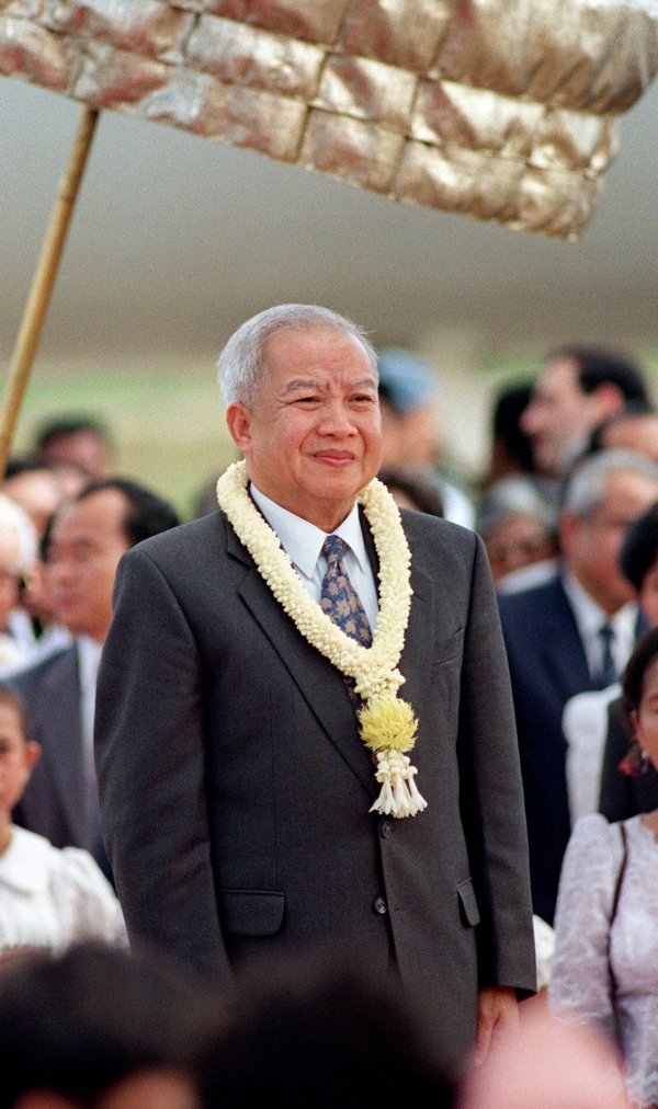 Former Cambodian king Norodom Sihanouk died of a heart attack in Beijing at the age of 89 on Oct 15, 2012. Sihanouk is shown here listening to the national anthem upon his return to Phnom Penh from a medical check-up in Beijing in 1993, when Cambodia was taking tentative steps toward democracy under a new constitution. (Doug Niven/AFP/Getty Images)