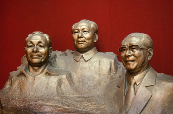 A statue displaying, from left, Deng Xiaoping, Mao Zedong, and Jiang Zemin, photographed in Beijing, China on August 9, 2010. (Mills Baker/Flickr)