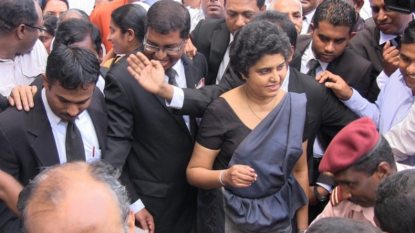 Sri Lanka's Chief Justice Shirani Bandaranayake (C) walks from the Supreme Court in Colombo on December 4, 2012. (Vikalpa/Groundviews/CPA/flickr)