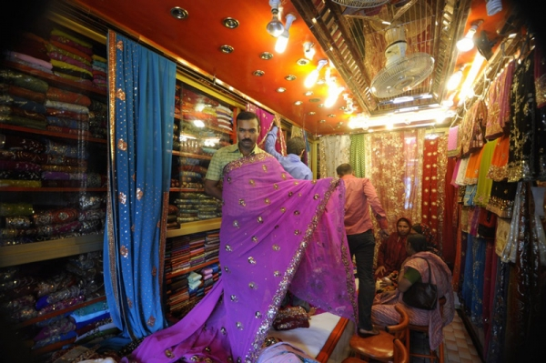 A Bangladeshi salesman displays saris at a textile shop during Ramadan in 2009. Ramadan is the Muslim majority nation's busiest time for retail sales with clothes the most popular item given during Eid-ul-Fitr, which marks the end of Ramadan. (Munir Uz Zaman/AFP/Getty Images)