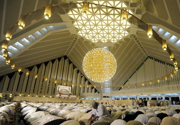 Pakistani Muslim worshippers offer Lailat al-Qader prayer at the Grand Faisal Mosque in Islamabad in 2009. Lailat al-Qader, (Night of Power), on which the holy Koran was first revealed to the Prophet Muhammad, falls on the 27th night of Ramadan. (Aamir Qureshi/AFP/Getty Images)