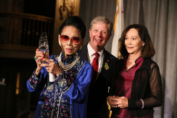 From left, Madame Sylvia Wu, Restauranteur is awarded the Culinary Legacy Award by Thomas E. McLain, Chair, Asia Society of Southern California and presenter actress Nancy Kwan during the Asia Society Southern California 2014 Annual Gala held at the Millennium Biltmore Hotel on Monday, May 19, 2014, in Los Angeles, Calif. (Photo by Ryan Miller/Capture Imaging)