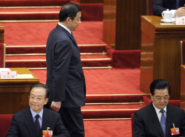 Bo Xilai (C), former Communist Party secretary of Chongqing arrives next to Chinese President Hu Jintao (R) and Premier Wen Jiabao (L) during the third plenary session of the National People's Congress's (NPC) annual session at the Great Hall of the People in Beijing on March 9, 2012. (Liu Jin/AFP/Getty Images)