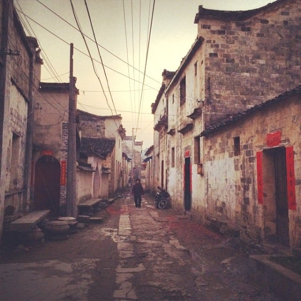 In the late afternoon of New Year's eve, after the first round of firecrackers, the village alleyways start to accumulate the remains of the firecrackers' red paper wrapping. (Sun Yunfan)