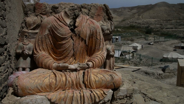 A gold-plated seated Buddha overlooks the China Metallurgical Group Corporation mine. (Brent Huffman)