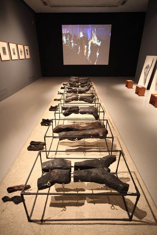 """Burned Victims."" FX Harsono, 1998. Burned wood, metal, shoes, and performance video with sound Dimensions variable; Video duration: 8 minutes, 41 seconds. Singapore Art Museum Collection."