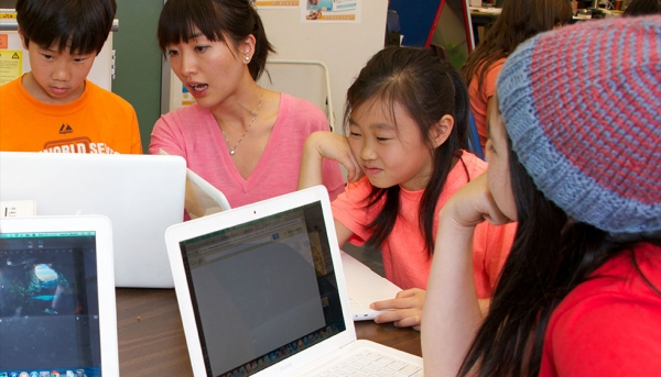 Chinese Ed Tech Coordinator Xiaoqing Chen with students (Chinese American International School)