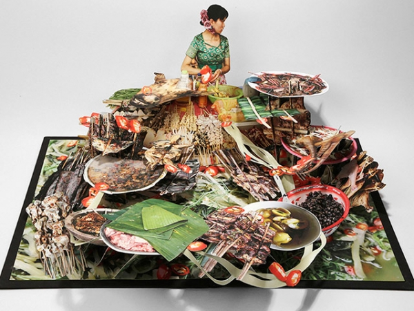 "This spread from visual artist Colette Fu's new pop-up book ""We Are Tiger Dragon People"" depicts the cuisine of the Dai community. (Colette Fu)"