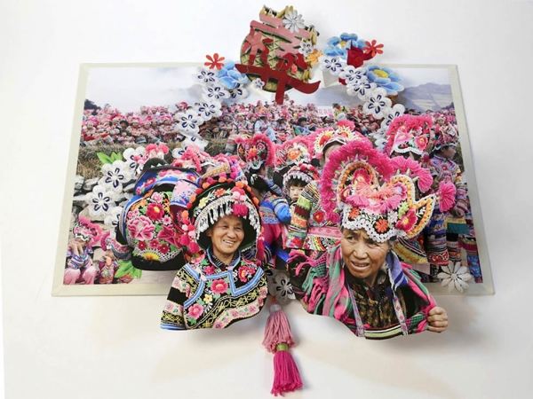 This spread, from Colette Fu's latest pop-up book, depicts the legend underlying a Yi village's custom of wearing cockscomb hats that bring luck, safety and happiness to its people. (Colette Fu)