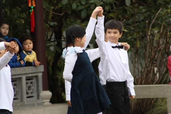 Students perform a social dance at the Lan Su Chinese Garden. (Chao Liu)