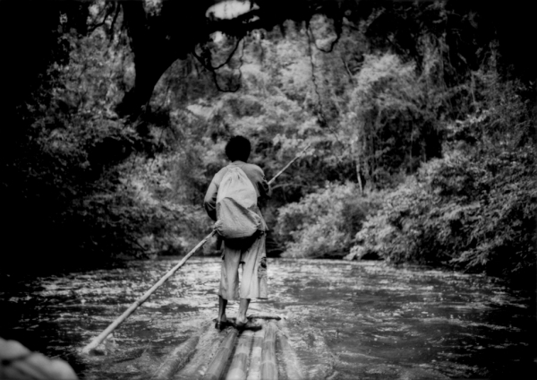 When fishing, Sam navigates his bamboo raft down the Sungai (River) Pertang to avoid a long walk back to his settlement. (James Whitlow Delano)