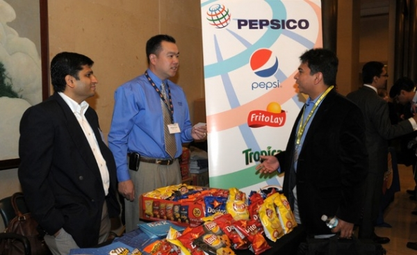 Participants at the PepsiCo display table.