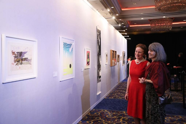 Asia Society Global Co Chair Henrietta H. Fore and Elizabeth Lancaster viewing 2017 Asia Arts Awards Hong Kong auction offerings.