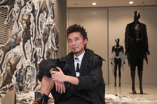 Hong-Kong-based designer Yeung Chin in front of his artworks.