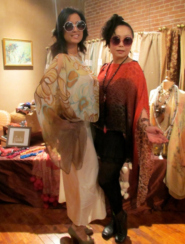 Designer Monique Zhang (r), of Cicada, poses with a shopper