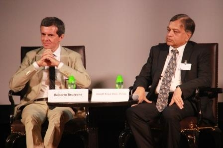 L to R: Professor Roberto Bruzzone and Professor Joseph Sriyal Malik Peiris of the University of Hong Kong in the post-screening discussion on June 20, 2014. (Asia Society Hong Kong Center)