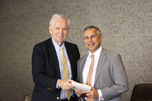 Asia Society Texas Center board member Charles Foster presents Ambassador Mirpuri with a gift. (Asia Society Texas Center - Paul Pass)