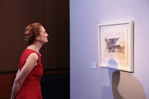 "Asia Society Global Co Chair Henrietta H. Fore viewing ""Phoenix"" (2011), donated by artist Xu Bing."