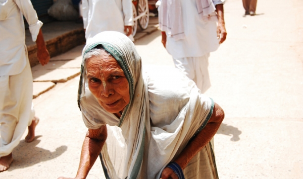 In Varanasi, India, Hinduism's holiest city, a widow begs on the streets in a white sari. According to tradition she must remain here until her death. (Shreeya Sinha)