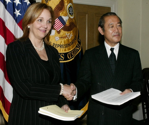 U.S. Deputy Trade Representative Josette Sheeran (L) shakes hands with Japanese Deputy Foreign Minister Ichiro Fujisaki on October 14, 2004 at the Trade Representative Building in Washington, D.C.(Stephen Jaffe/AFP/Getty Images)