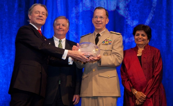 Admiral Mike Mullen, Chairman of the Joint Chiefs of Staff (3rd from left), receives the Public Policy Award on behalf of the U.S. Armed Forces. From L to R: Asia Society Washington Chairman Leo. A. Daly III and Lockheed VP for Global Security Policy Bill Inglee; and Asia Society President Vishakha N. Desai during Asia Society Washington's Annual Dinne, June 9, 2010, at the Ritz-Carlton in Washington DC. (Les Talusan/Asia Society)