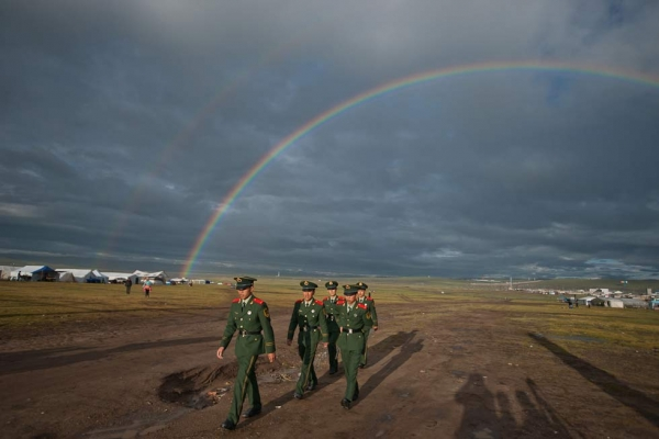 Nakchu, at the crossroads of Route 317 and the Qinghai-Lhasa highway, holds the largest Horse Festivals in Tibet. The double rainbows arcing over a group of Chinese policemen were an auspicious sign for 2011's celebration; in 2010, it was cancelled due to political unrest. (Michael Yamashita)