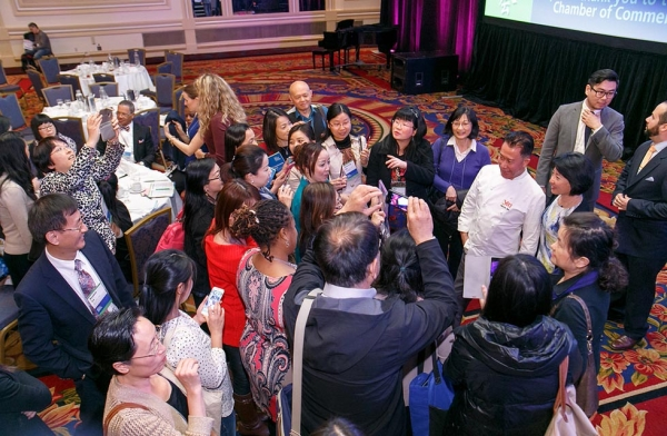 NCLC attendees gather around Martin Yan after his panel. (David Keith)