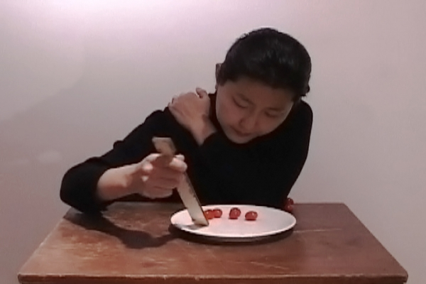 Eating (Self-Portrait) by Hye Yeon Nam, single channel video, 2006. Collection of the artist © Hye Yeon Nam