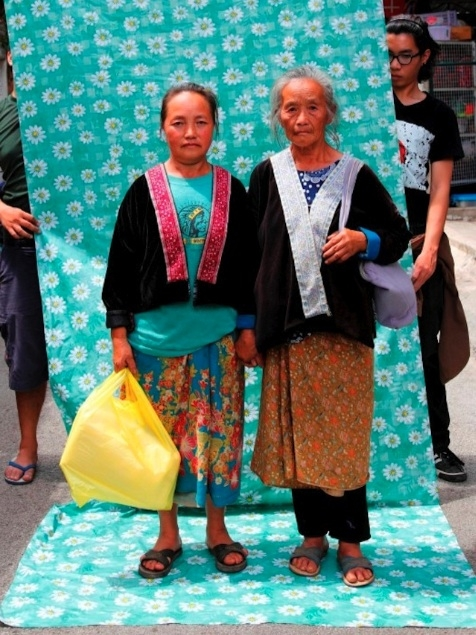 Two of Wasiksiri's subjects shopping at a street market in Chiang Mai (Lost at E Minor)