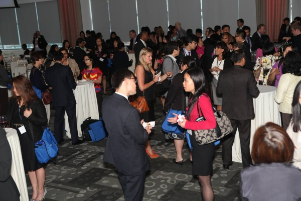 Delegates mingle during the Awards Ceremony cocktail reception