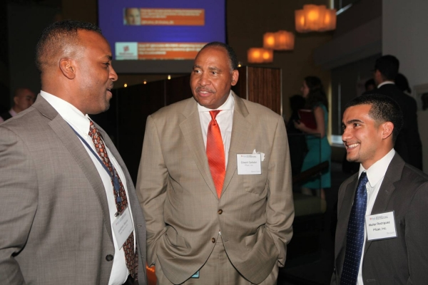 Edward Gadesden Jr., Chief Diversity Officer at Pfizer, Inc. (center) with Forum attendees