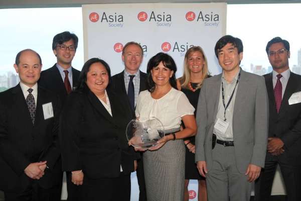 Kathy Hannan and KPMG LLP delegates with the Award for Overall Best Employer for Asian Pacific Americans