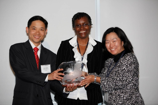 L to R: Allan Castro and Millicent Small-Williams of Colgate-Palmolive Company receiving the Award for Best Company for Asian Pacific Americans to Develop Workforce Skills from Linda Akutagawa