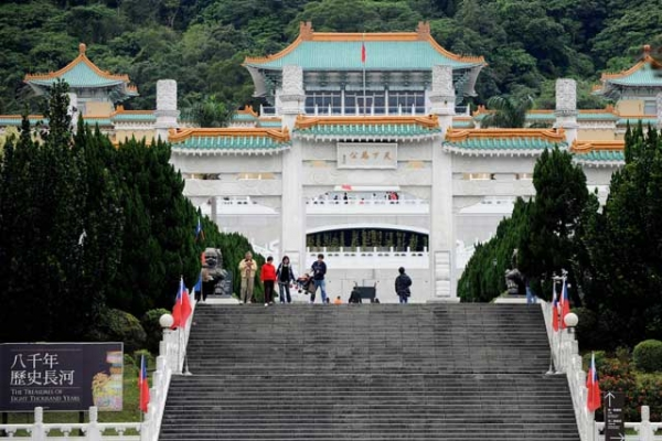 Tourists walk in front of the National Palace Museum in Taipei on January 6, 2009. The museum and its counterpart in Beijing plan to hold a joint exhibition of artifacts and arrange exchange of visits by their officials, in yet another sign of fast improving ties between Taiwan and rival China (SAM YEH/AFP/Getty Images).