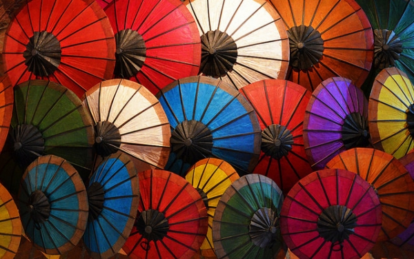 Traditional, colorful, oil-paper umbrellas clustered like flowers in Luang Prabang, Laos on May 10, 2014. (Attila Terbócs/ Flickr)