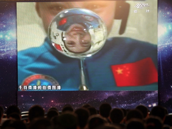 Chinese astronaut Wang Yiping becomes China's first space teacher as she broadcasts a live lesson to 300 students in a Beijing school from more than 300 kilometers above Earth's surface on June 20, 2013. (STR/AFP/Getty Images)
