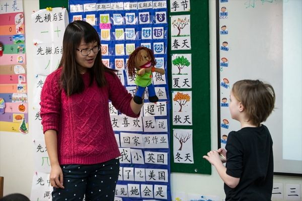 Using puppets and other props helps teachers create a classroom atmosphere where learning Chinese is interactive and engaging.