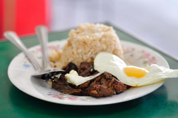 Tapsilog, a traditional Filipino meal primarily served during breakfast that consists of garlic-fried rice, tapa (dried beef), and fried egg. (Ryan Fernandez)