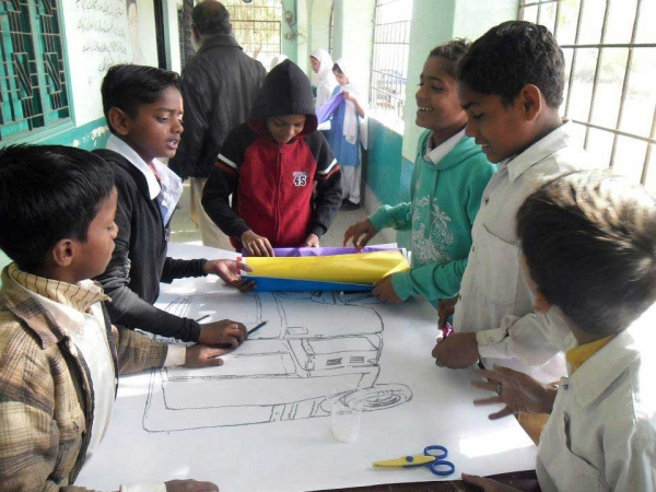 Students in the same workshop brainstorming design ideas for their Peace Rickshaw. (Pakistan Youth Alliance)