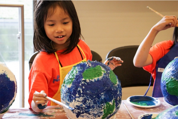 "Campers create globes with ""keys to a change-friendly world."" (Nikki Tripp)"