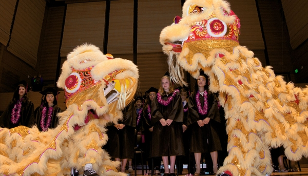 Student lion dancers perform and escort graduates following ceremony. (Chinese American International School)