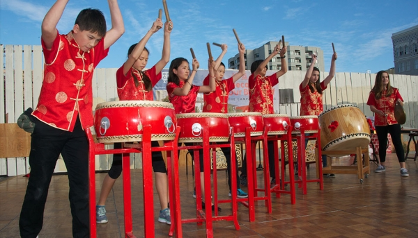 Student musicians perform at middle school groundbreaking. (Chinese American International School)