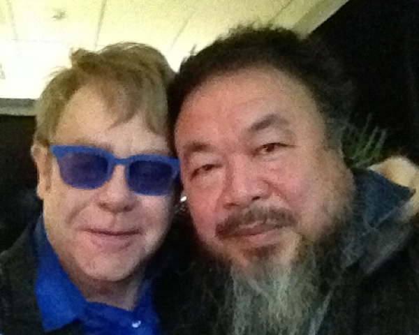 A grainy shot from Ai Weiwei's Instagram of him (R) and singer Elton John (L) backstage at the singer's Beijing concert on November 25. (Ai Weiwei/Instagram)