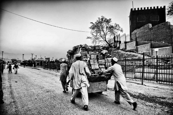 The Afghan half of Torkham is a one-road town that leads into Pakistan. The street bustles with humanity, chatter and trucks. (Suchitra Vijayan)