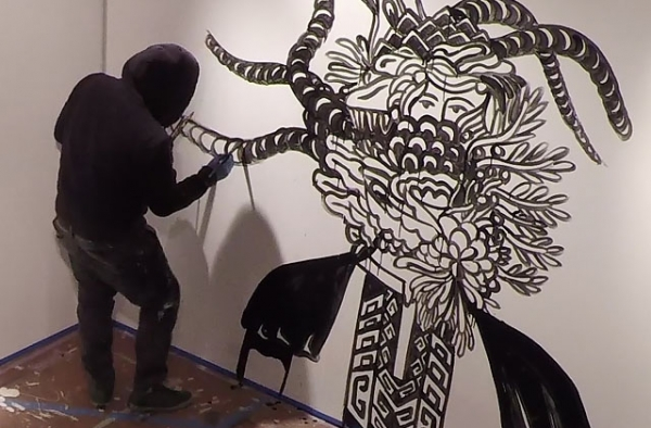 Eko Nugroho paints a mural at Asia Society Museum in New York. (Salvador Pantoja/Asia Society)