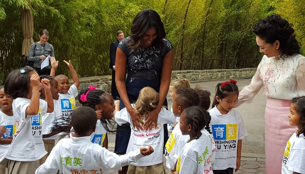 Pre-kindergarten students with U.S. First Lady Michelle Obama and China First Lady Peng Liyuan at the National Zoo for the panda Bei Bei's naming ceremony. (Yu Ying Public Charter School)