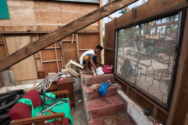 Two men start to rebuild their home in the aftermath of Typhoon Yolanda, Cebu.